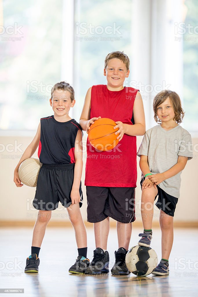Young Boys Playing Sports stock photo