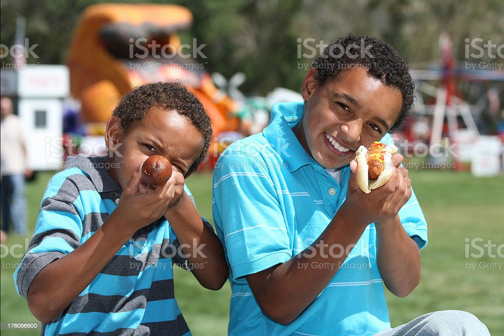 Young boys playing with their food royalty-free stock photo
