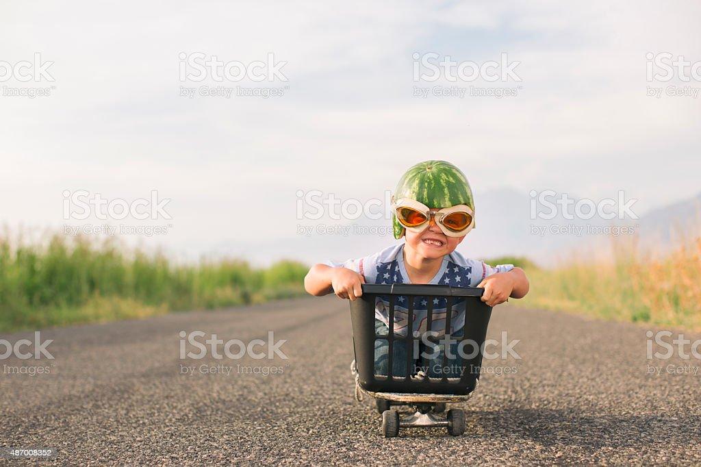 Young Boys Racin Wearing Watermelon Helmet stock photo