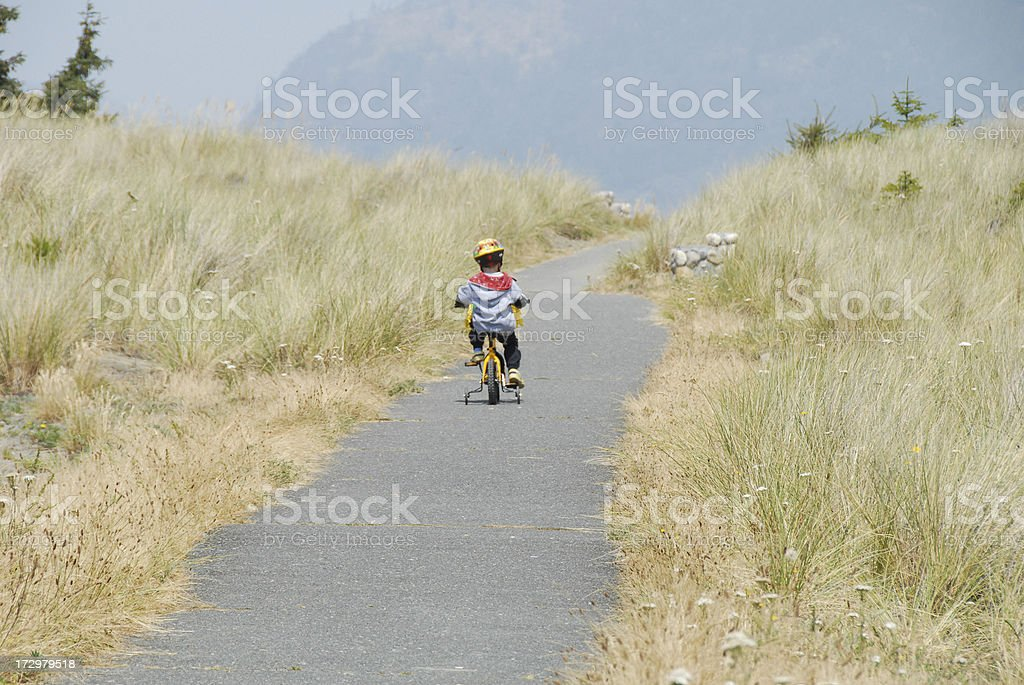 Young Boy's Sand Dune Bike Ride stock photo