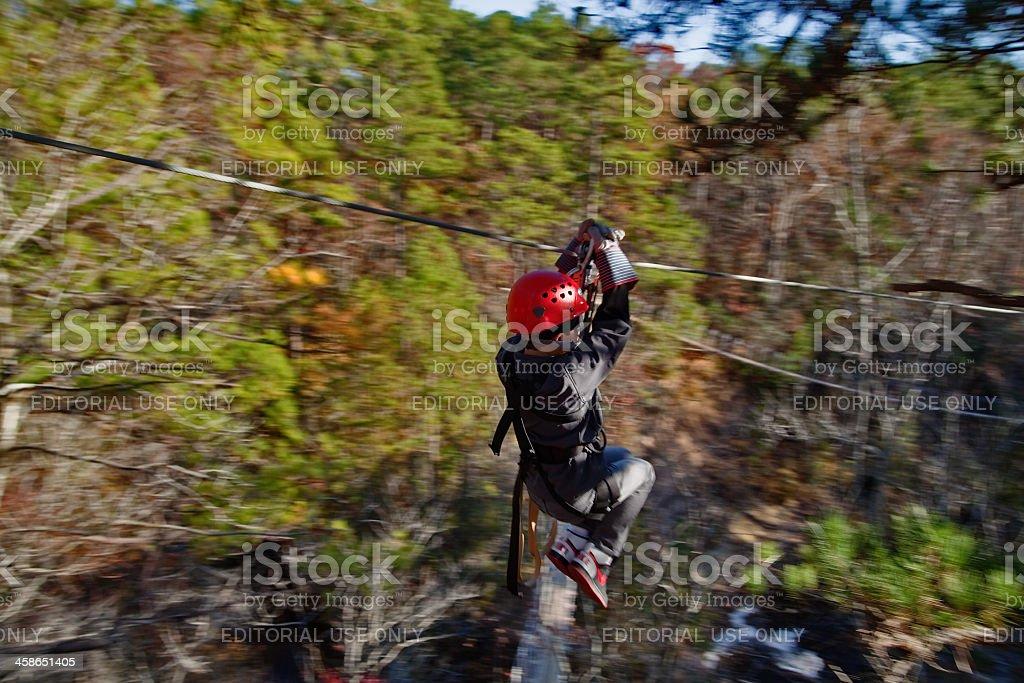 Young boy's zipline adventure stock photo