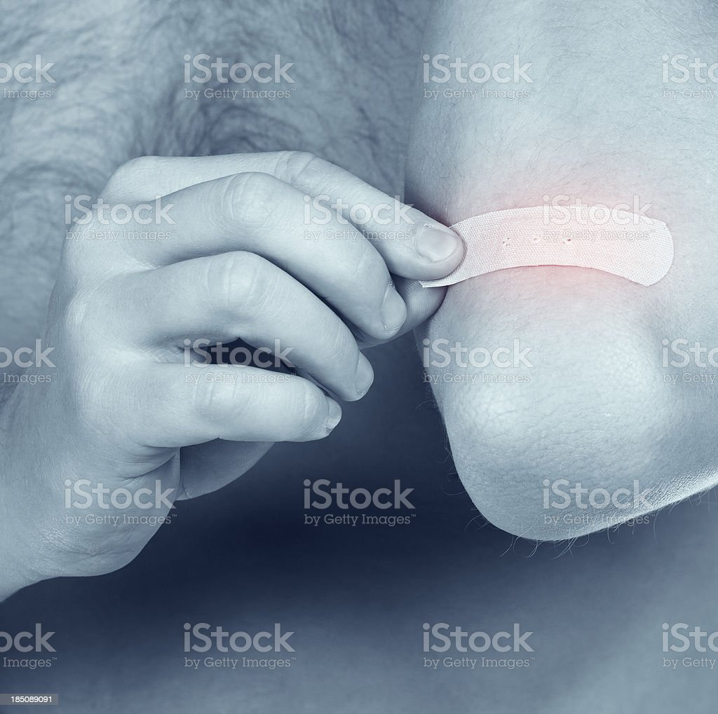 young brawny guy tests an acute pain in  elbow royalty-free stock photo