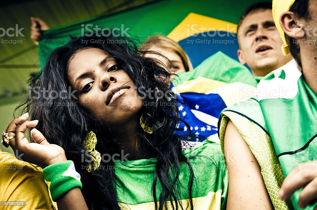 Young brazil supporter looking at you stock photo