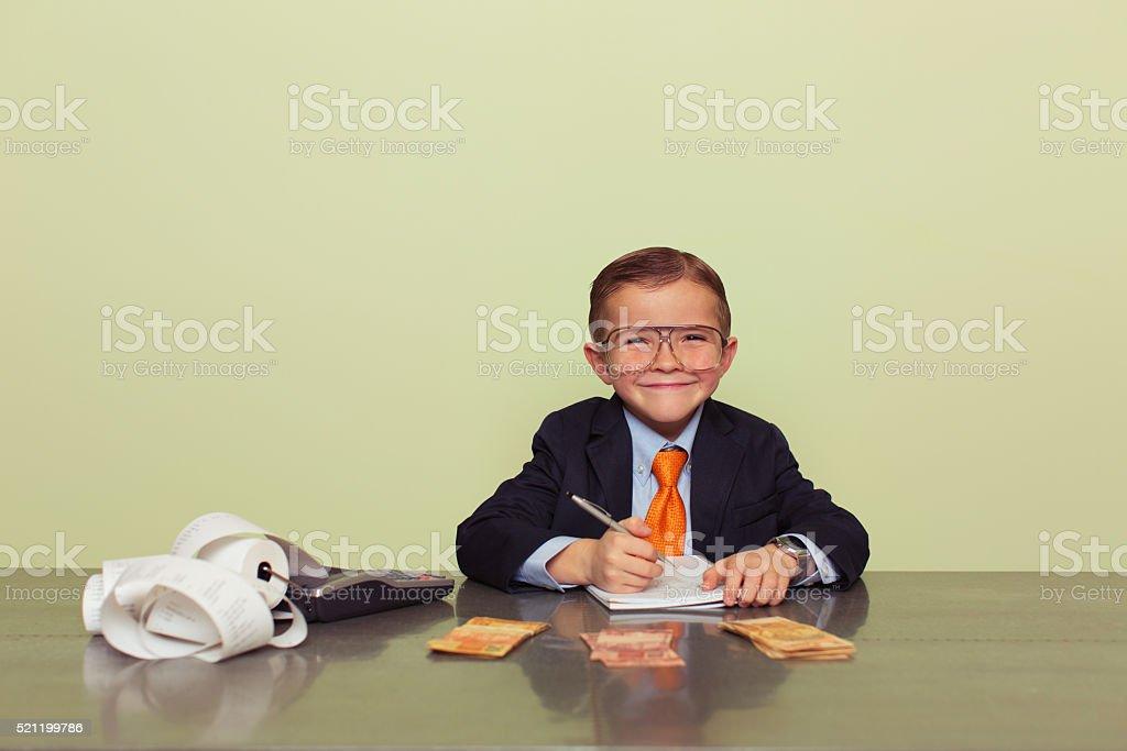 Young Brazilian Boy Accountant with Money stock photo