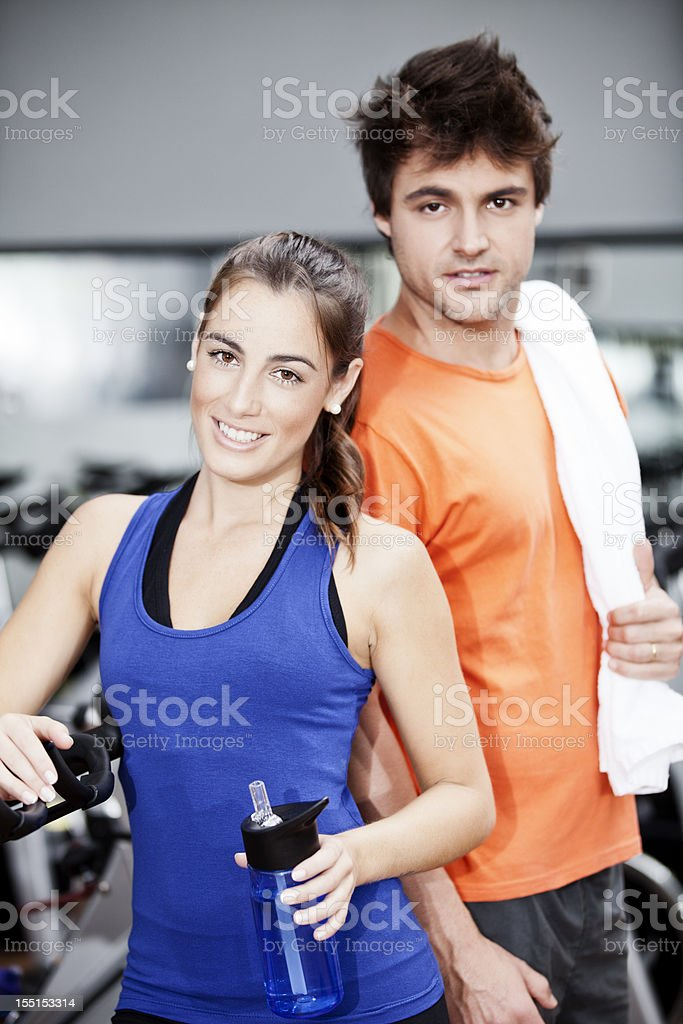 Young Brazilian man and woman in a gym royalty-free stock photo
