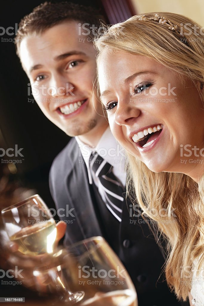 Young Bride and Groom Enjoying Wedding Receptions With Guests royalty-free stock photo