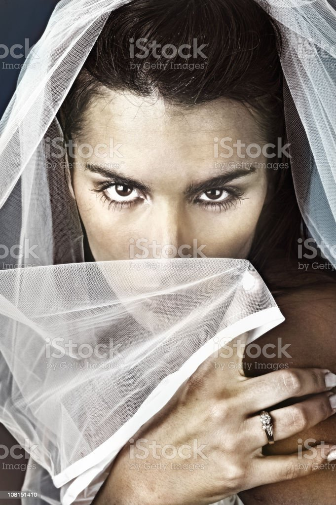 Young Bride Holding Veil Over Face and Showing Wedding Ring royalty-free stock photo