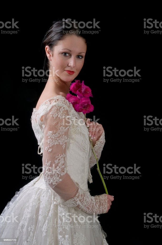 Young bride holds gladiolus. royalty-free stock photo