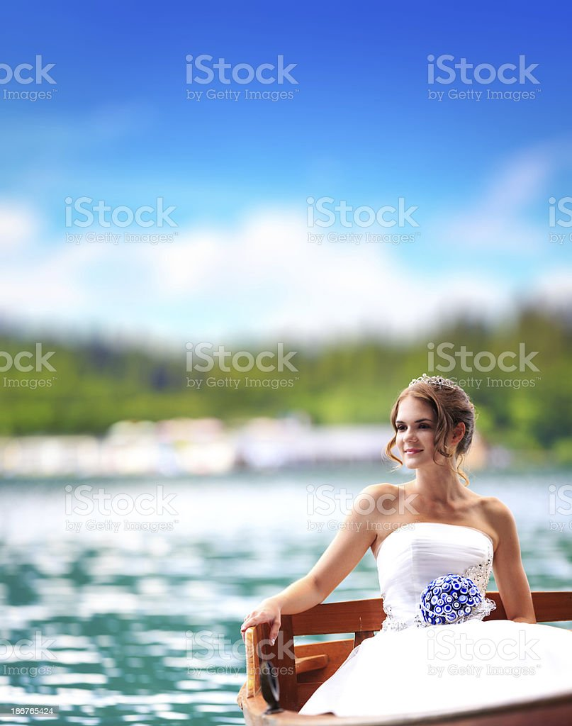 Young Bride In a Boat royalty-free stock photo