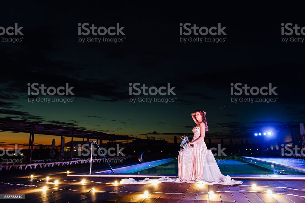young bride in luxury wedding dress. evening stock photo