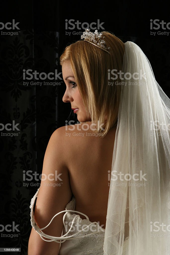 Young bride looking over her bare shoulder royalty-free stock photo