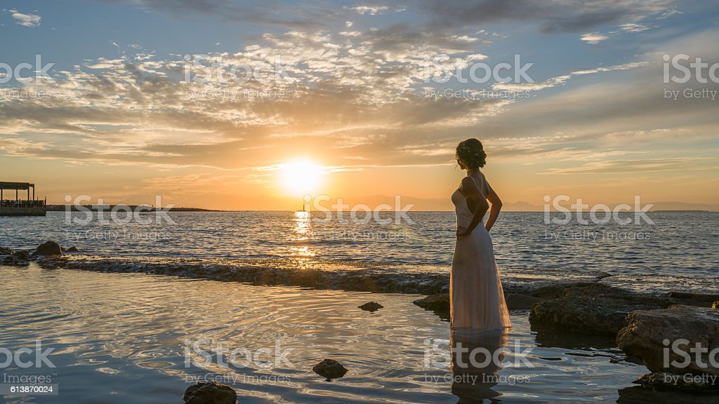 young bride women on the beach sunset.. stock photo