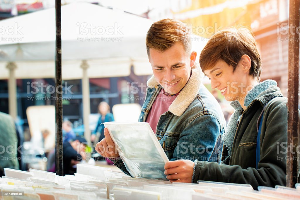 Young British couple find rare vinyl record at local fair stock photo