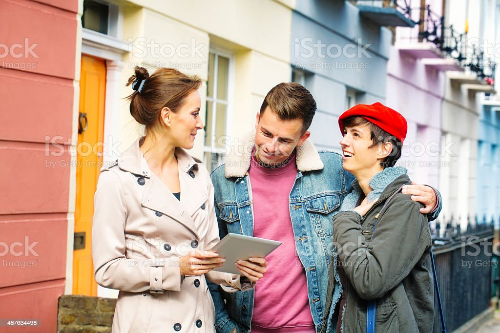 Young British couple shopping for real estate with female agent stock photo