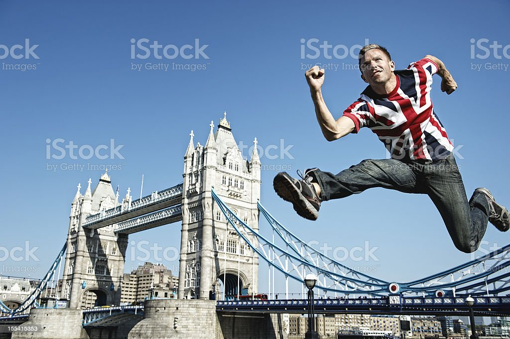 Young British Man Jumping Over Tower Bridge London stock photo