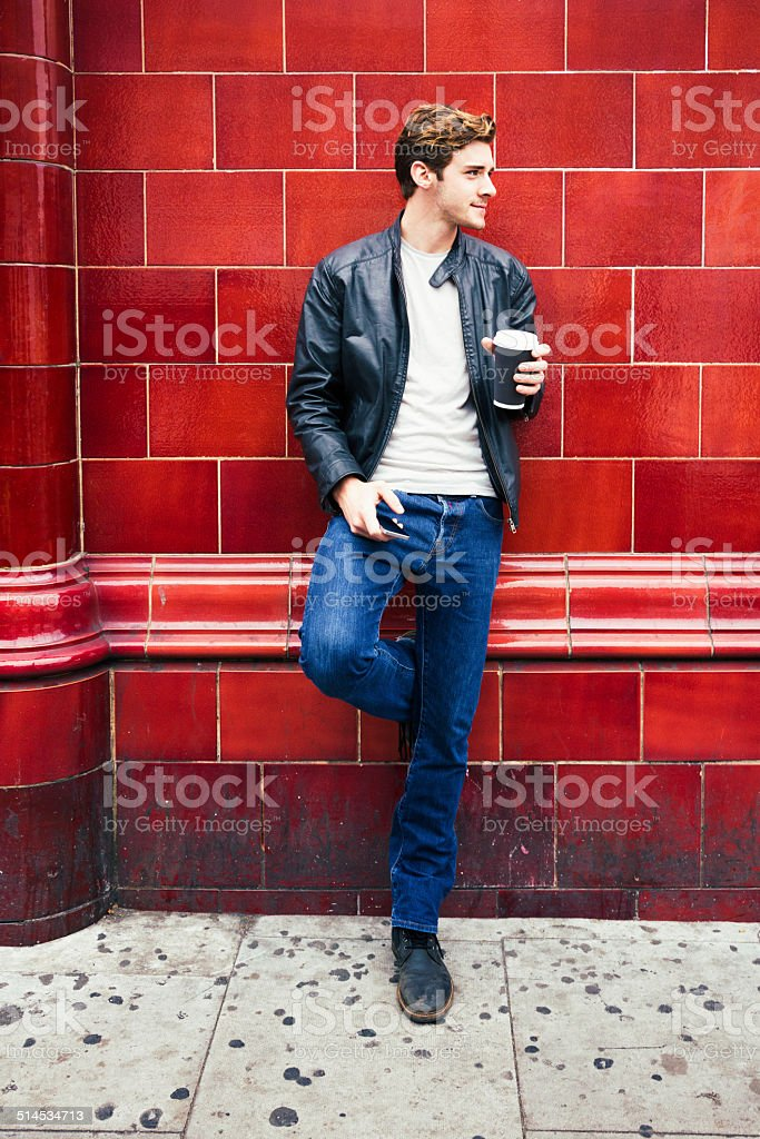 Young British man waiting for the bus stock photo