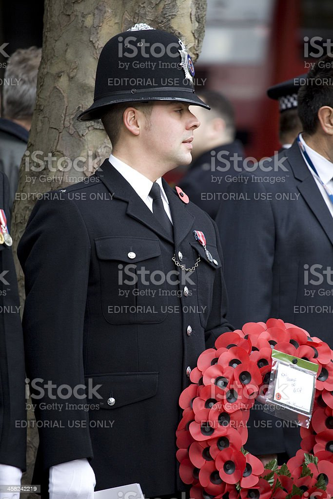 Young British Transport Police Officer With A Poppy Wreath stock photo