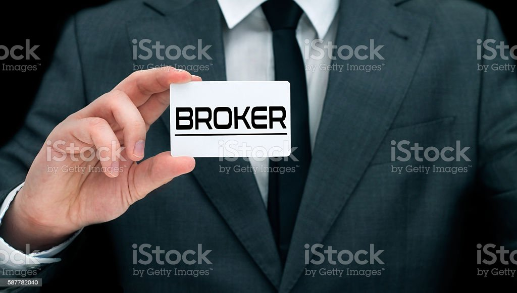 Young broker showing his business card. stock photo