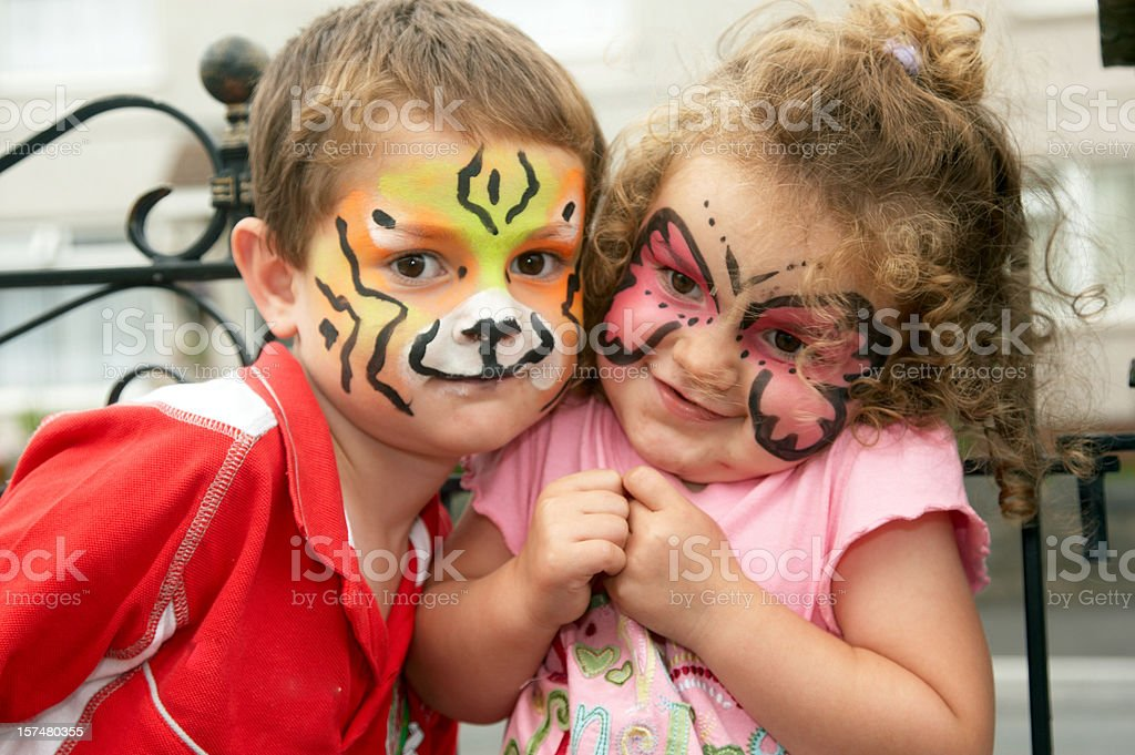 Young brother and sister face painting portrait stock photo