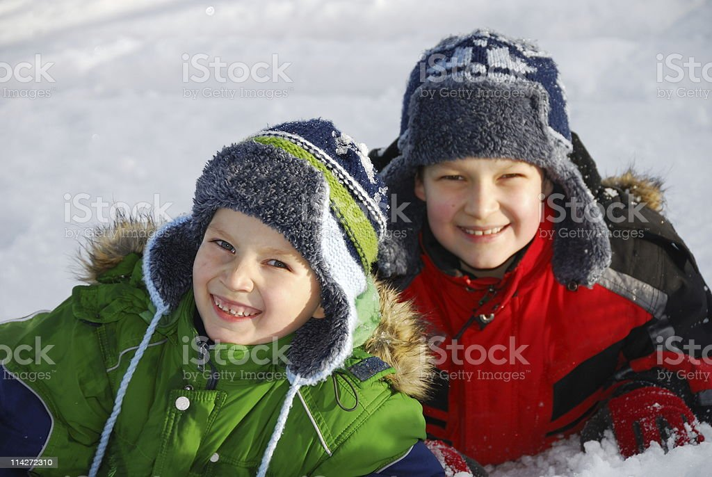 Young Brothers In Snow royalty-free stock photo