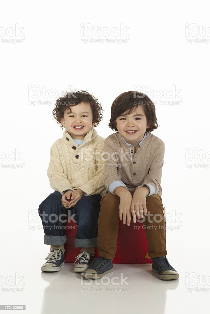 Young Brothers on White Background. royalty-free stock photo