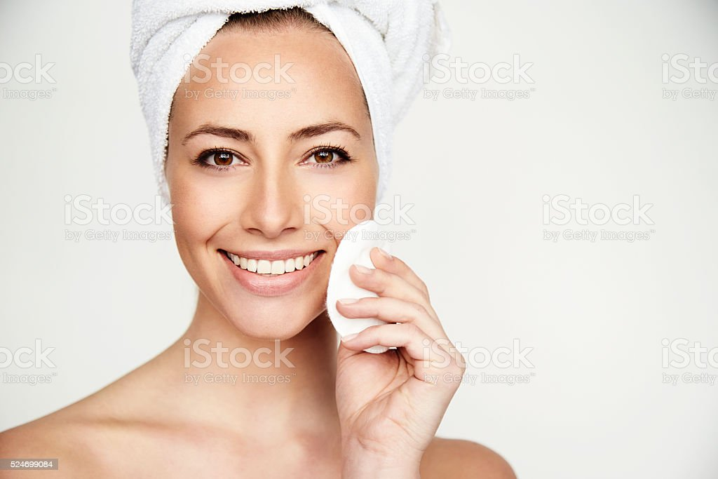 Young brunette beauty treatment smiling at camera stock photo