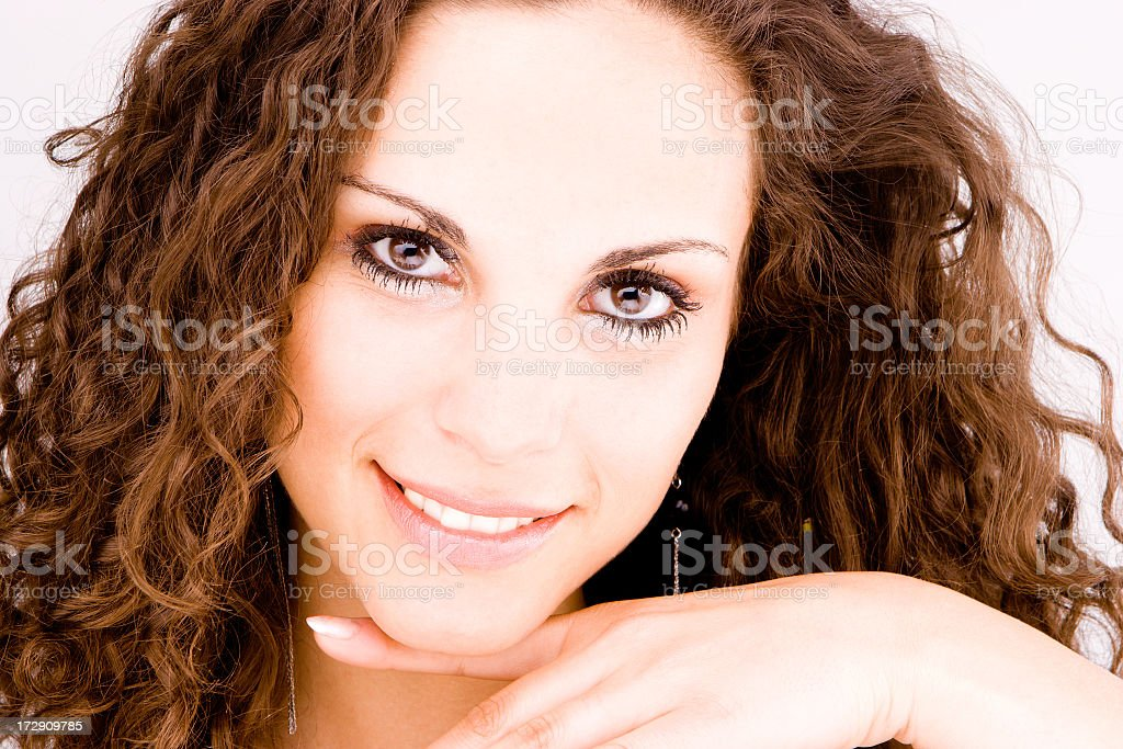 Young brunette beauty with curls stock photo