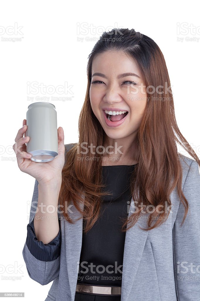 Young brunette businesswoman presenting a can of soft drink stock photo
