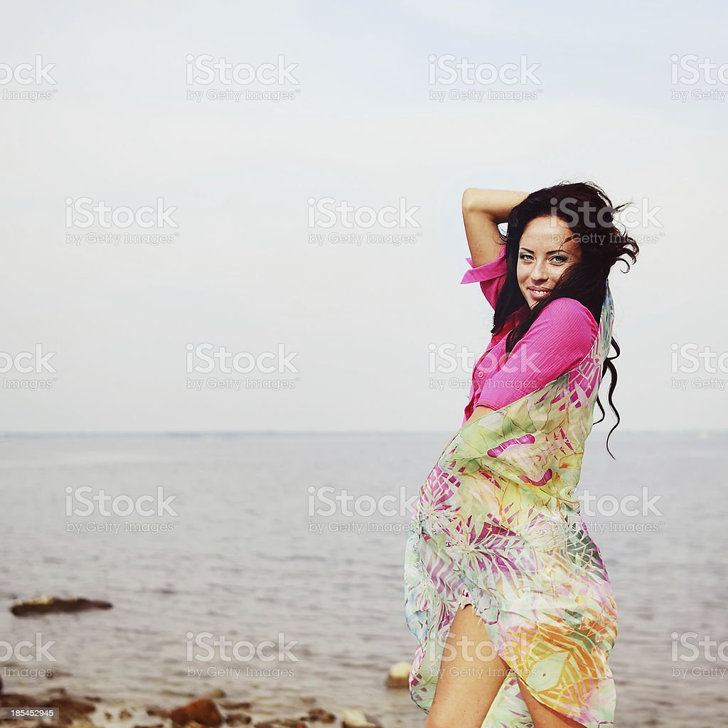 young brunette by the sea royalty-free stock photo