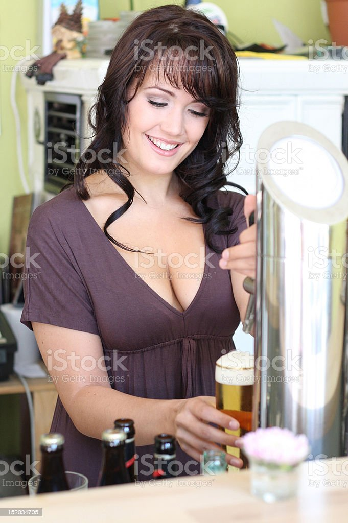 young brunette draws beer at the bar stock photo