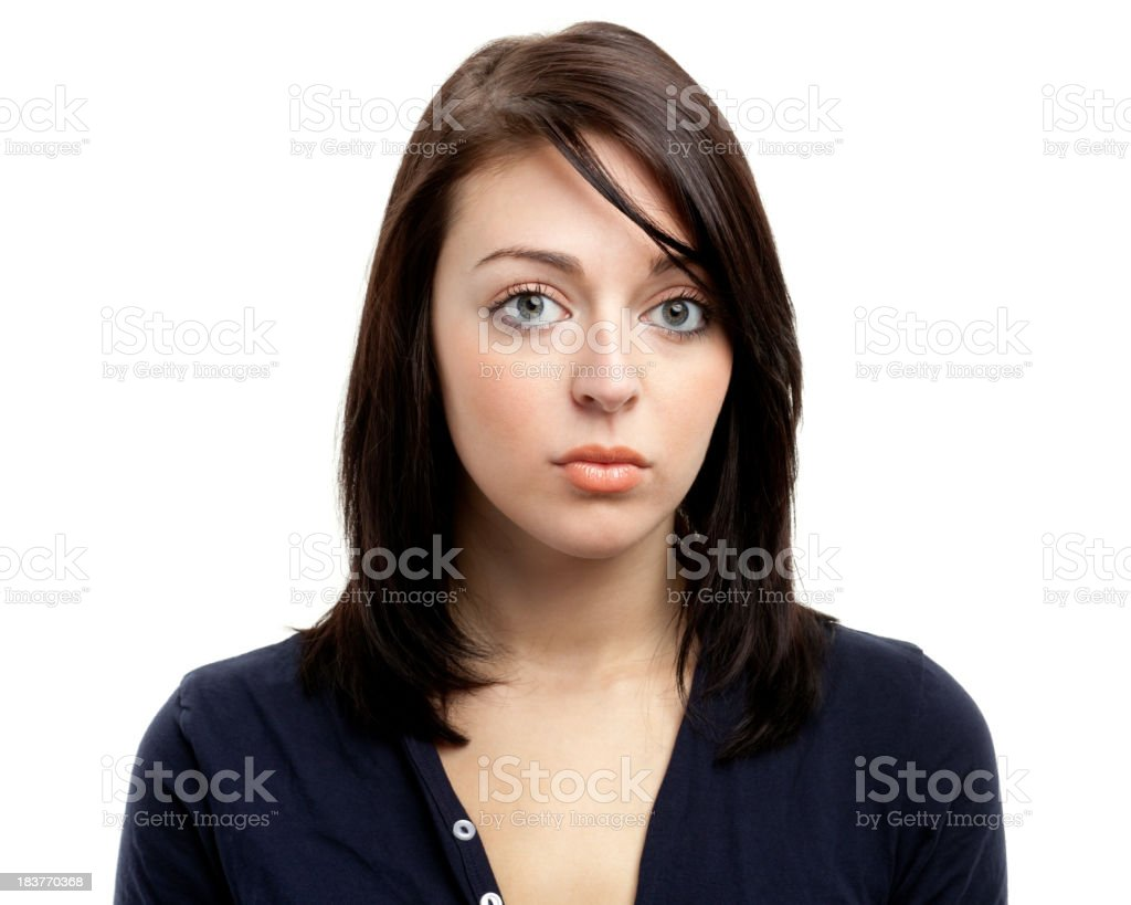 Young brunette female stares blankly into the camera lens royalty-free stock photo