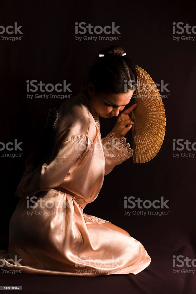 Young brunette girl with fans royalty-free stock photo