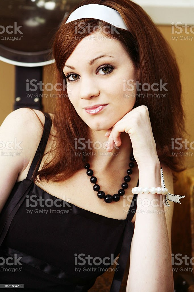 Young Brunette Girl with White Headband in Beauty Salon royalty-free stock photo