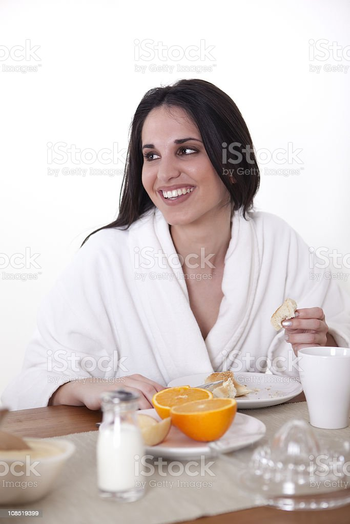 Young brunette is having healthy breakfast royalty-free stock photo