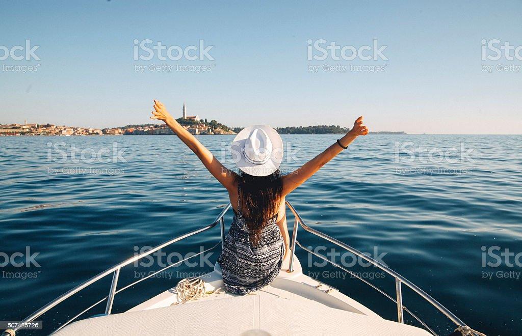 Young brunette on the boat enjoying summertime stock photo