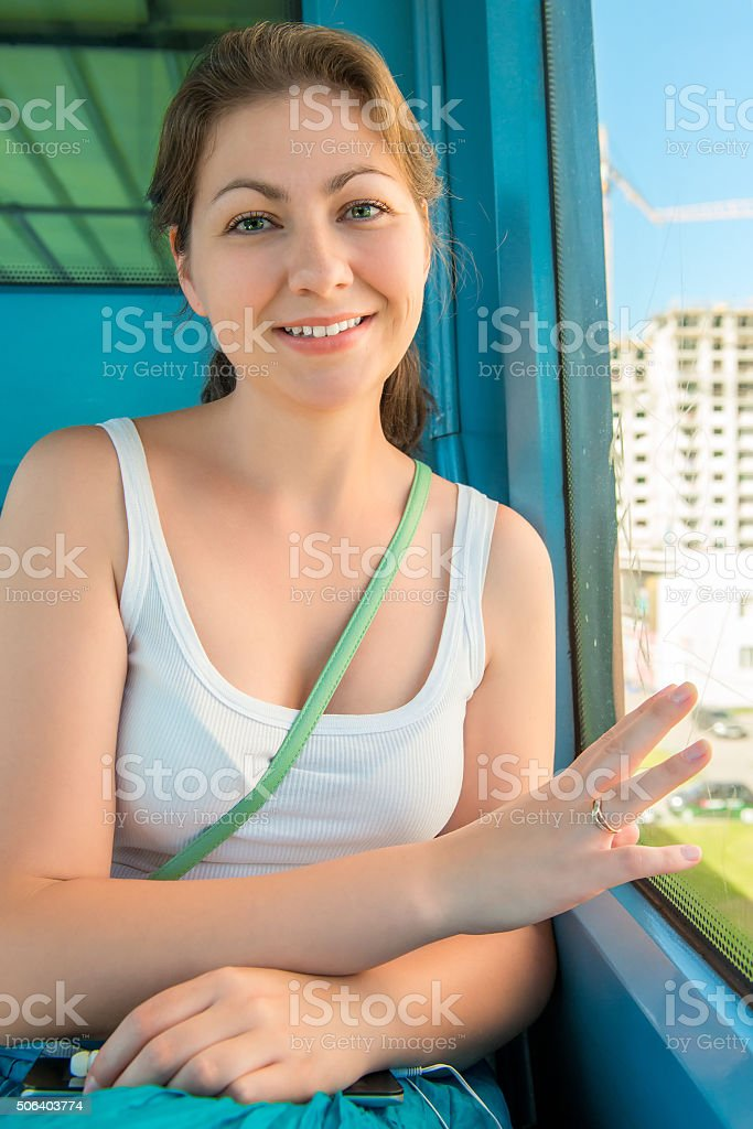 young brunette travels in the subway and smiling stock photo
