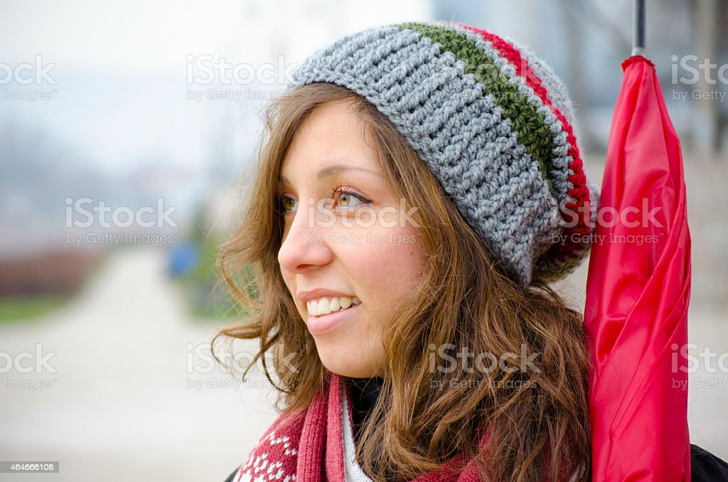 Young brunette wearing a hand made woolen hat royalty-free stock photo