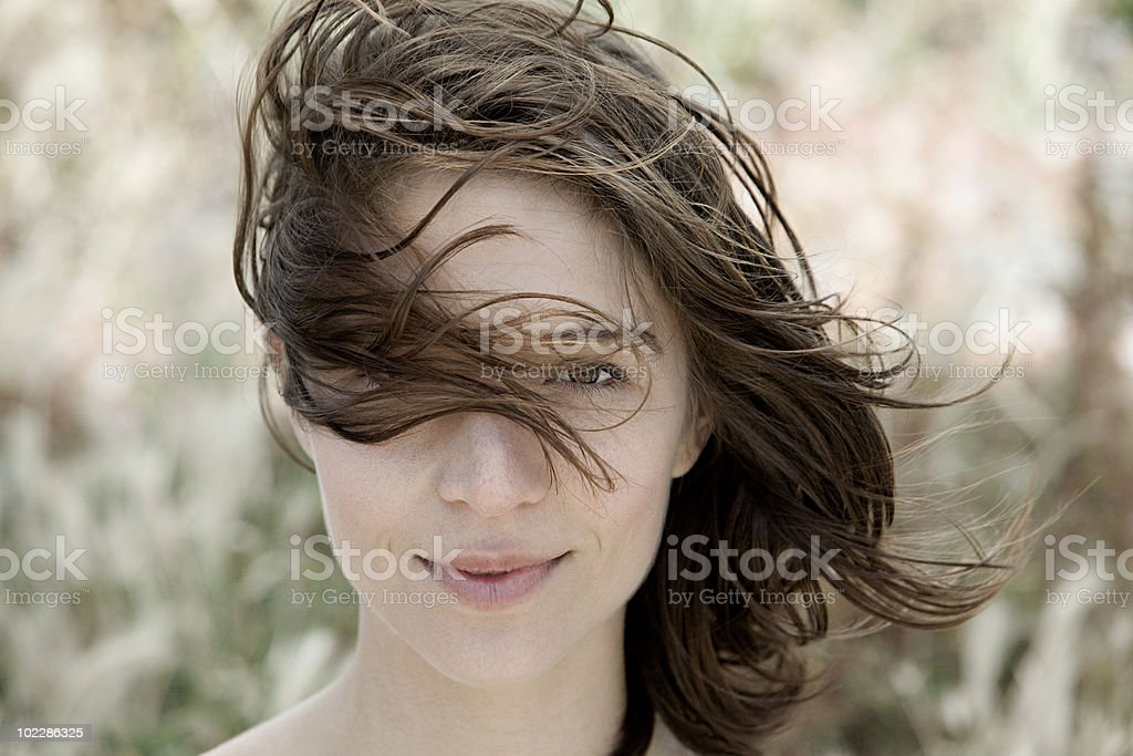 Young brunette woman alone outdoors, portrait stock photo