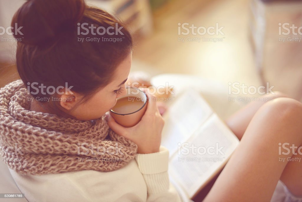 young brunette woman in home interior. stock photo