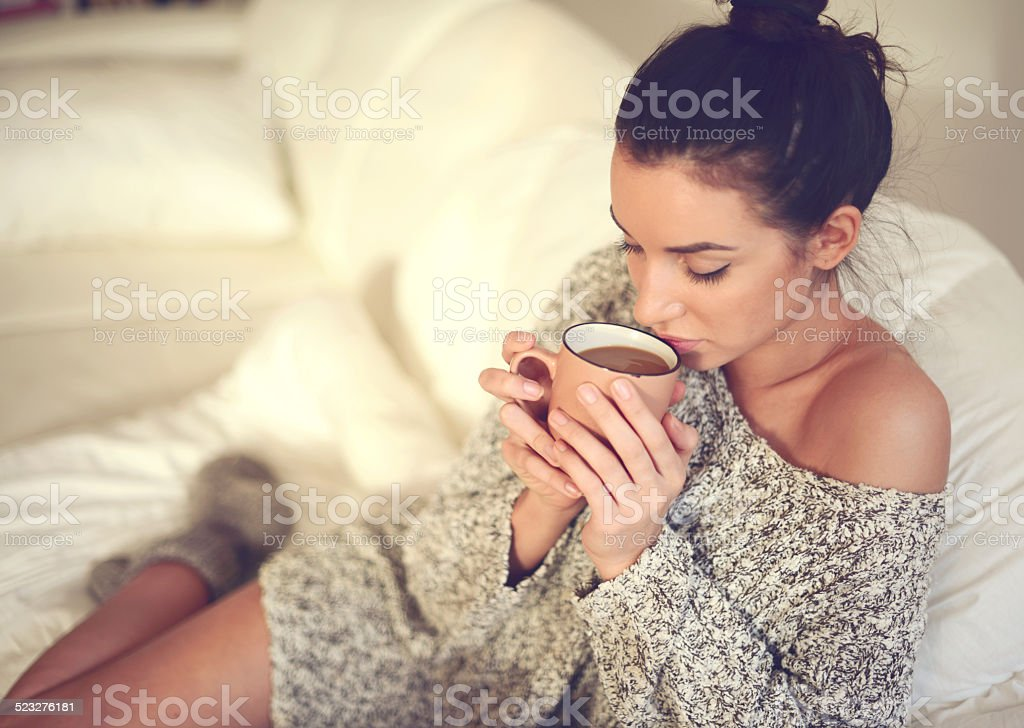 young brunette woman in home interior stock photo