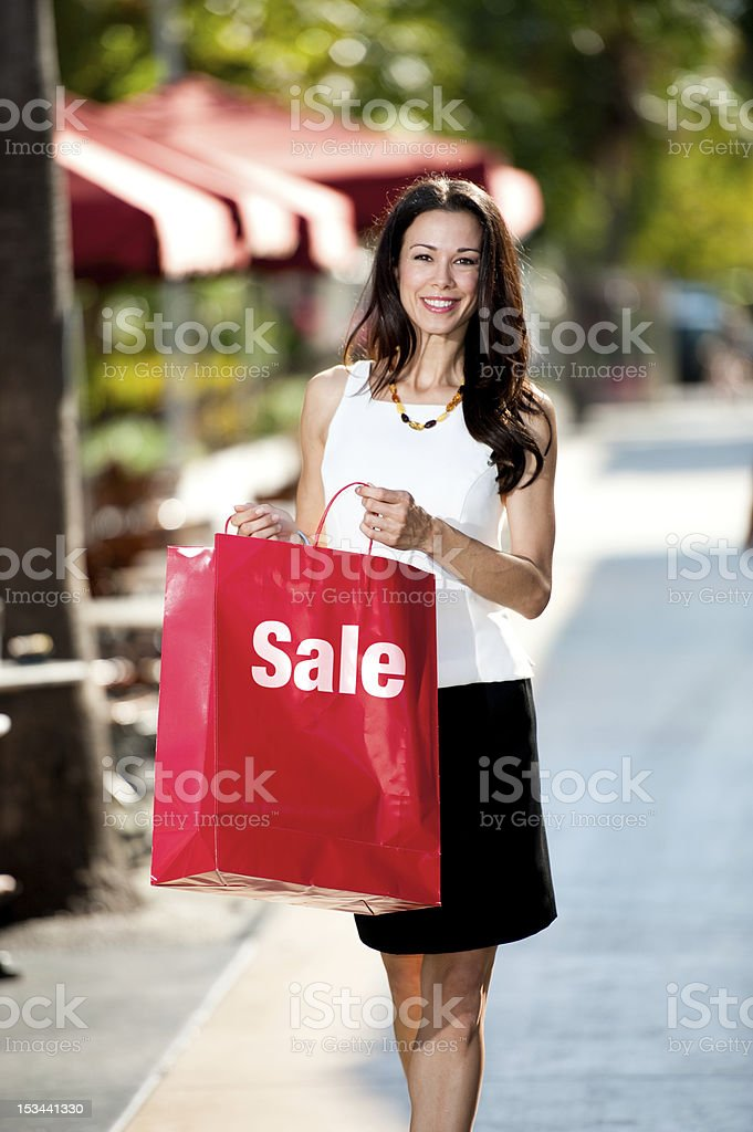 Young Brunette Woman Shopping with Bag royalty-free stock photo