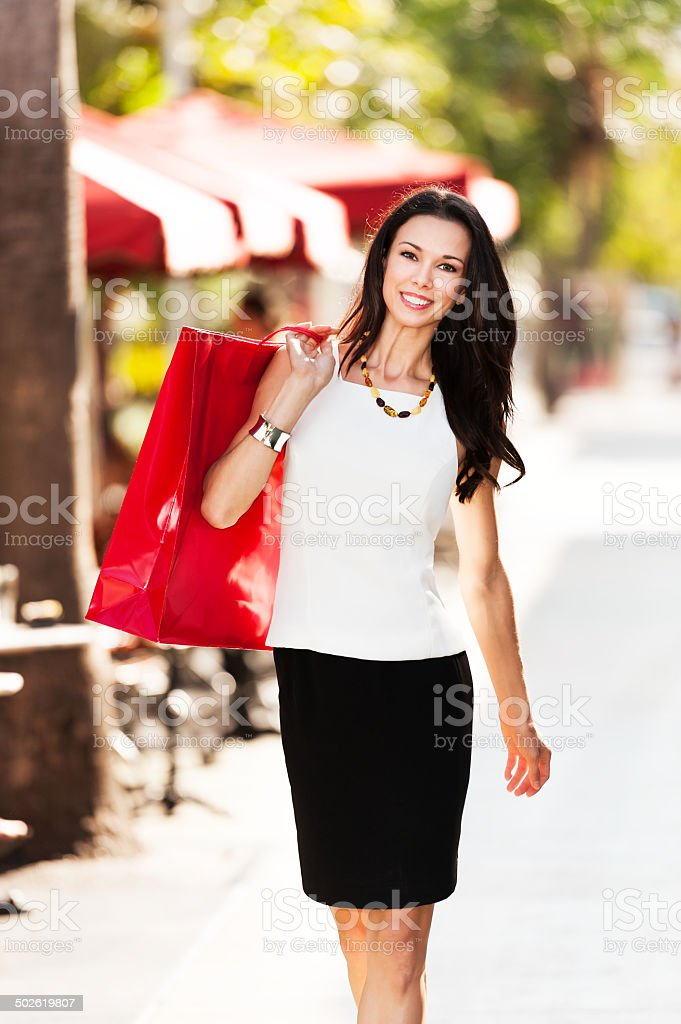 Young Brunette Woman Shopping with Bag stock photo