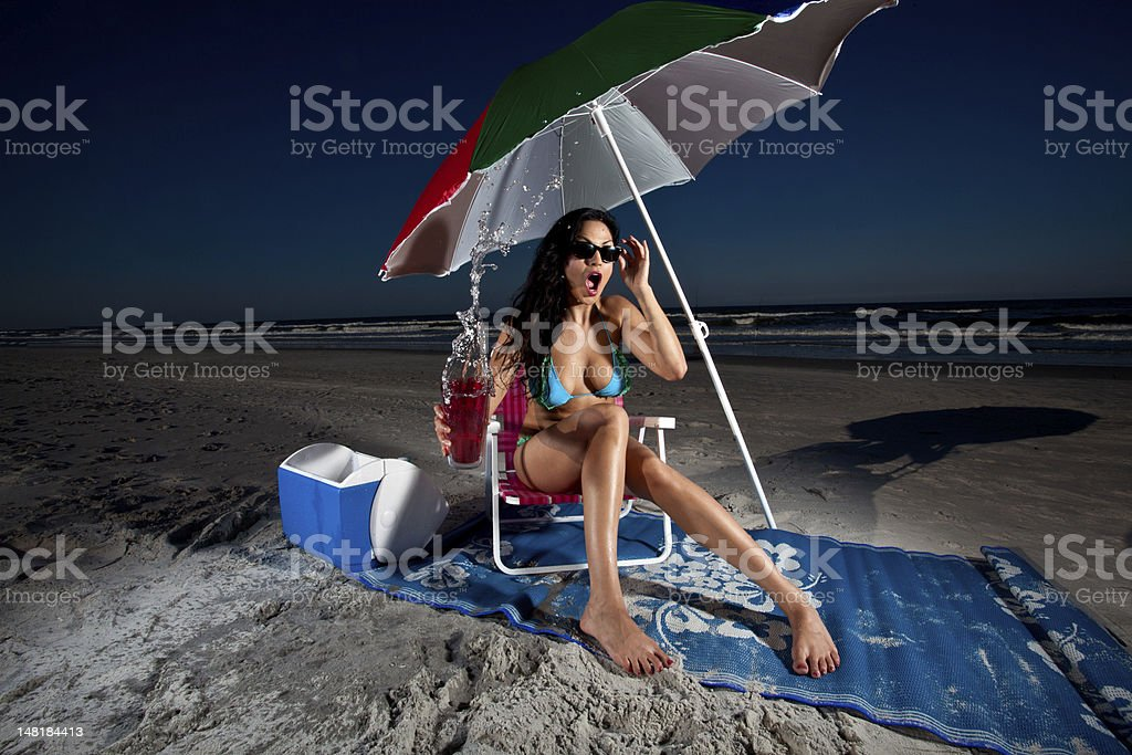 Young Brunette Woman sitting on chair at beach royalty-free stock photo