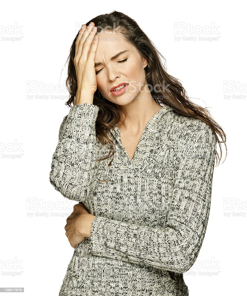 A young, brunette woman suffers from a headache royalty-free stock photo