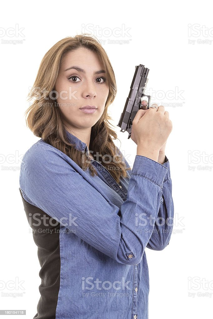 Young brunette woman with gun isolated on white royalty-free stock photo