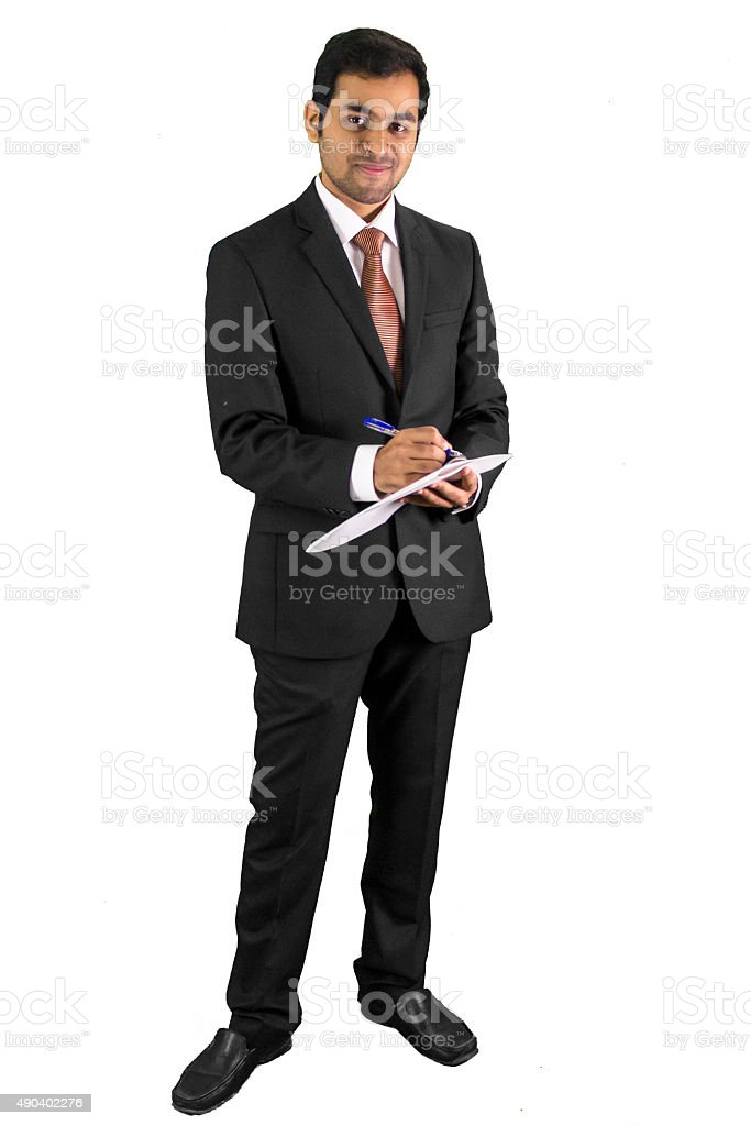 Young bsuiness man writing on white paper stock photo