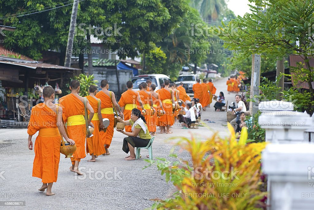 Young buddhist monks are collecting alms, Luang Prabang, Laos royalty-free stock photo