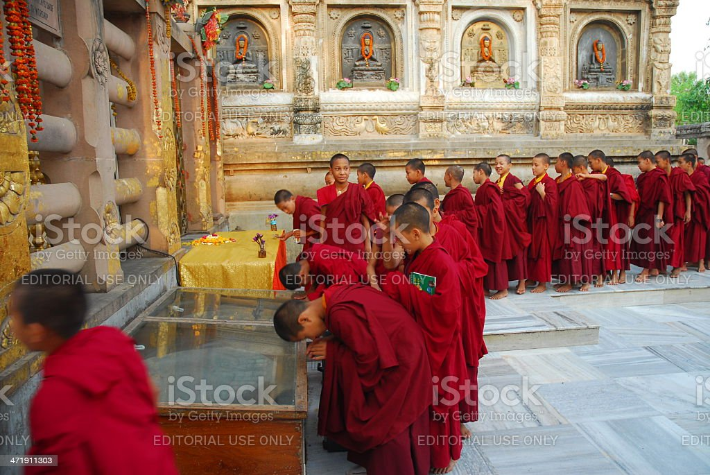 Young Buddhist monks standing in line at the temple ground stock photo