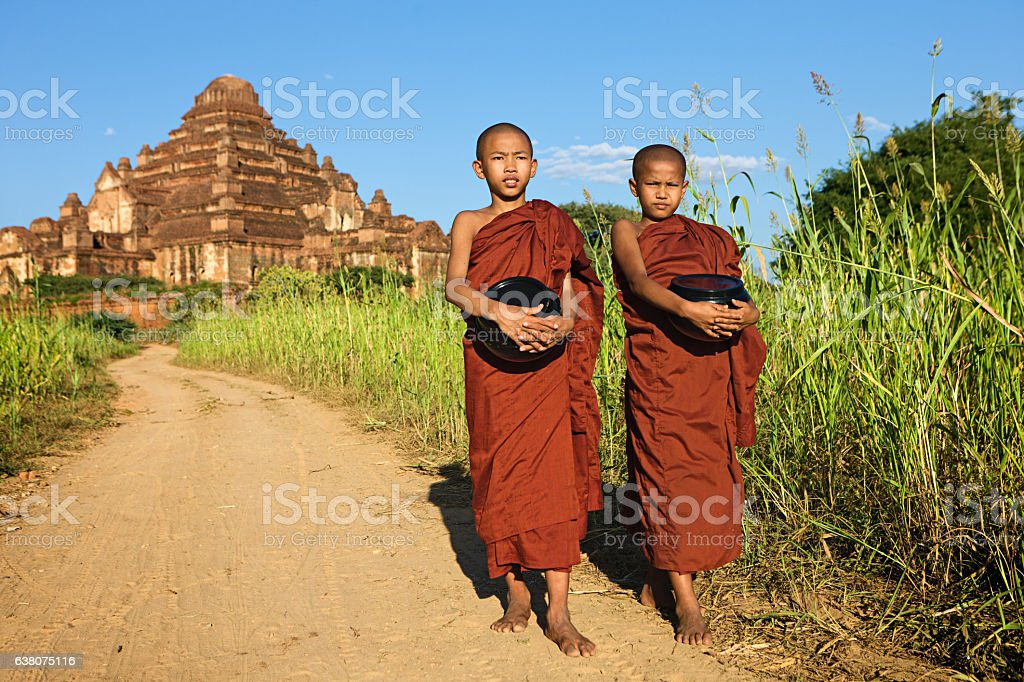 Young Buddhist monks walking in Bagan stock photo