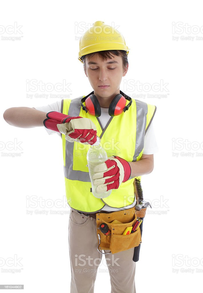 Young builder drinking a bottle of water royalty-free stock photo